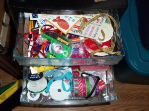 Disorganized scrapbook supplies in drawers